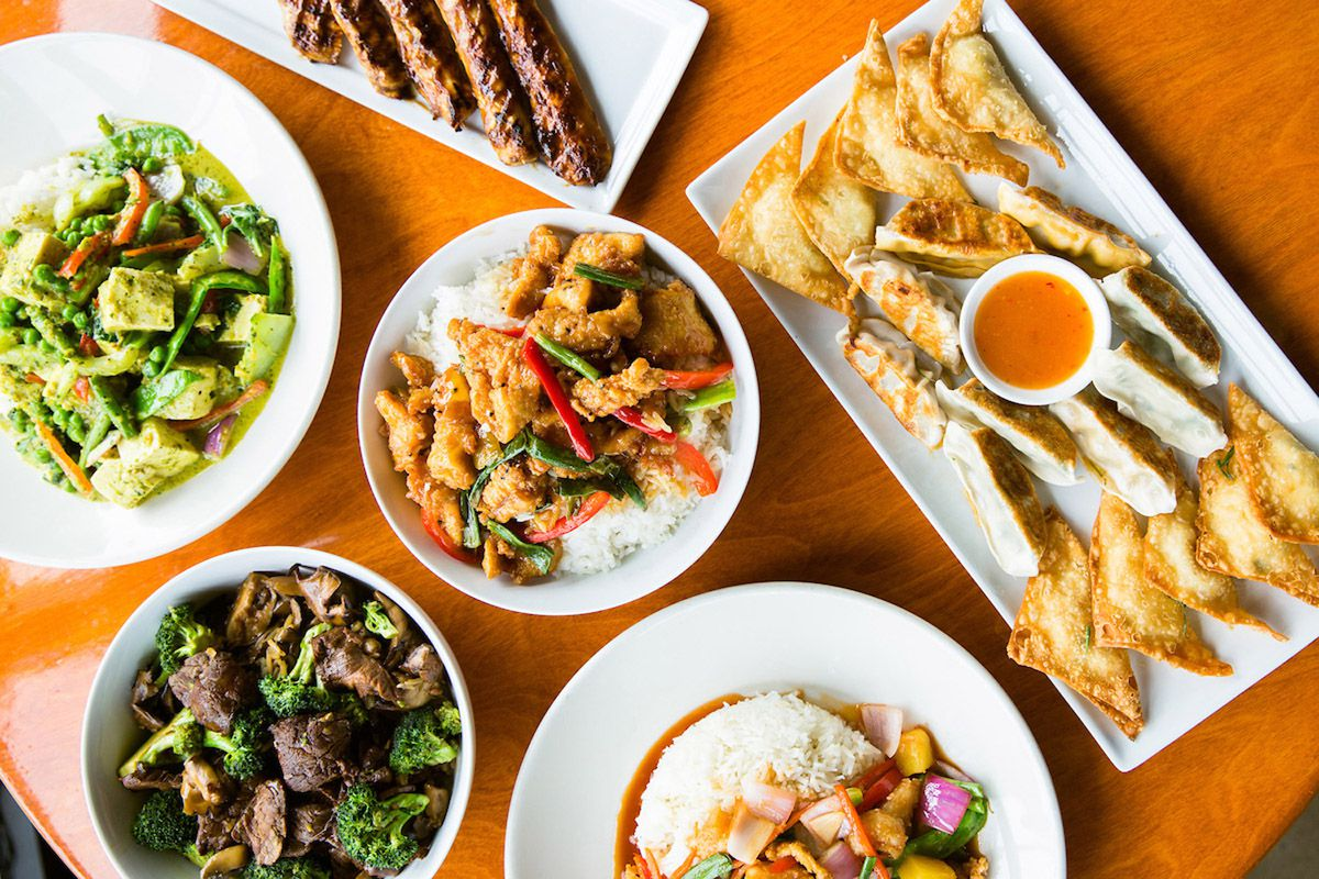 A variety of Asian dishes spread on a table.