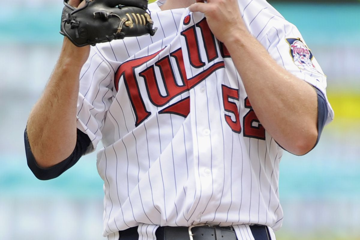 MINNEAPOLIS, MN - JULY 15: Brian Duensing #52 of the Minnesota Twins reacts during the first inning against the Oakland Athletics on July 15, 2012 at Target Field in Minneapolis, Minnesota. (Photo by Hannah Foslien/Getty Images)