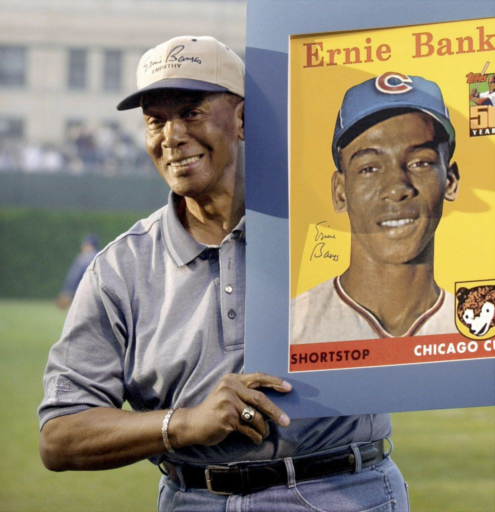 Former Chicago Cubs shortstop Ernie Banks holds an enlarged copy of his rookie baseball card May 16, 2001, at Wrigley Field.  (AP Photo/Fred Jewell)