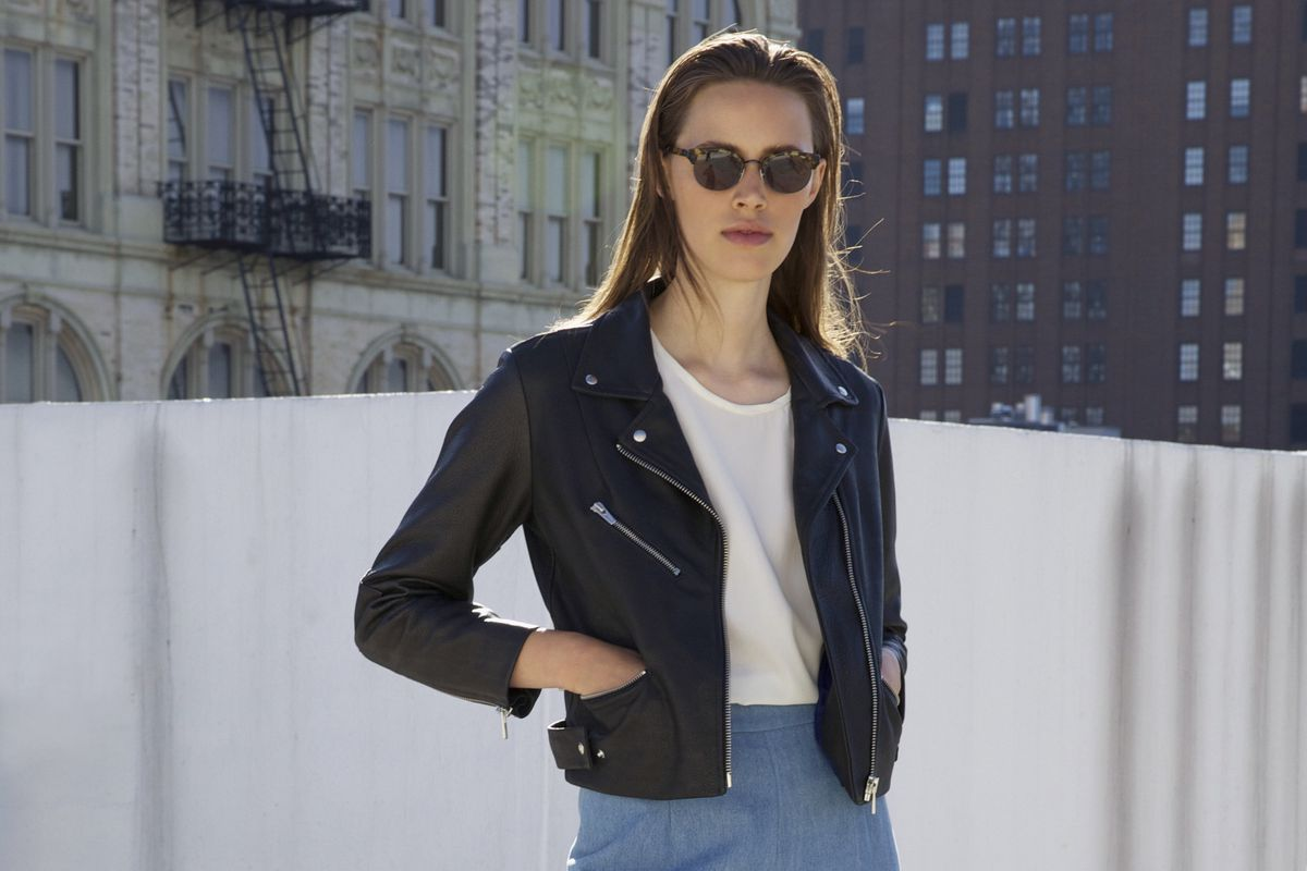 a woman in a leather jacket