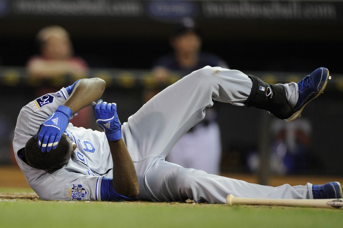 MINNEAPOLIS, MN - SEPTEMBER 11: Lorenzo Cain #6 of the Kansas City Royals lays on the ground after being hit in the head by a pitch during the eighth inning against the Minnesota Twins on September 11, 2012 at Target Field in Minneapolis, Minnesota.