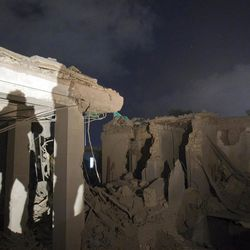 In this photo taken on a government organized tour, ruins of an official building are seen following an air strike in Tripoli, Libya, early Tuesday, May 10, 2011. (AP Photo/Darko Bandic)
