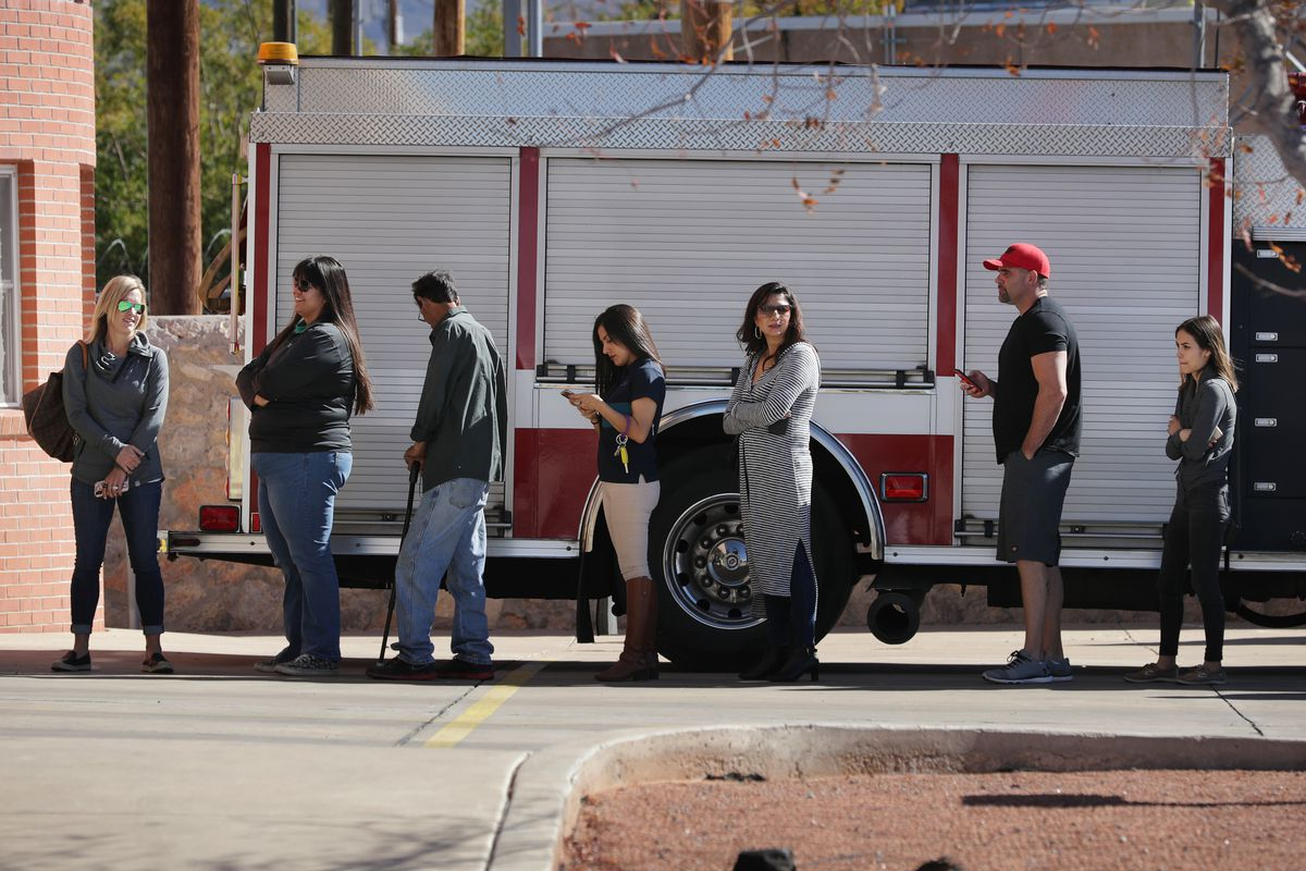 Voters line up outside a polling place in El Paso, Texas on November 6, 2018
