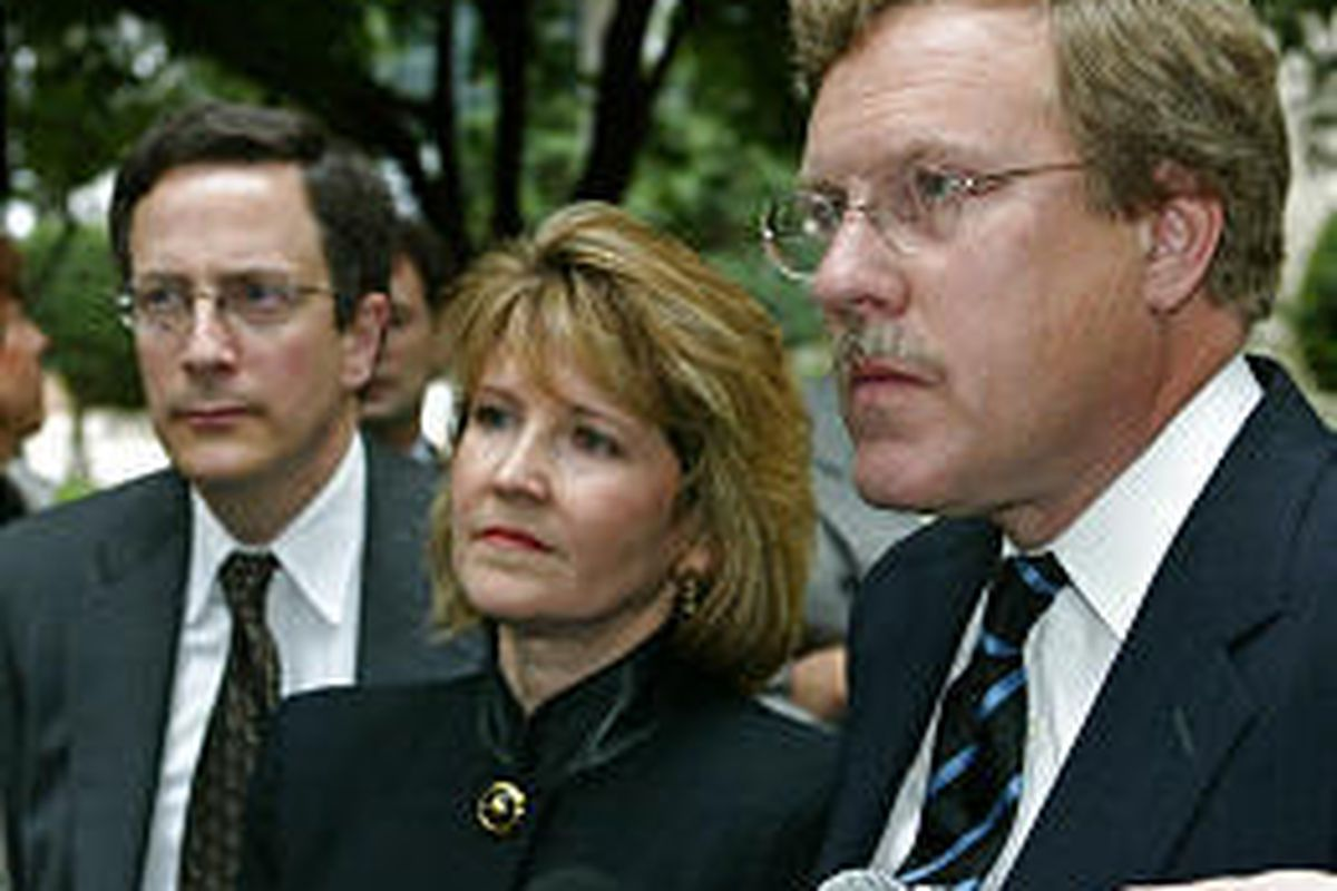 Attorneys David Smoridin, left, Carol Ann Petren and Dean Luthey field questions from the press following a court appearance in Oklahoma City on behalf of their client MCI.