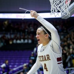 Cedar's Logann Laws (4) holds a piece of the basketball net after defeating Pine View for the 4A girls championship title at the Dee Events Center in Ogden on Saturday, Feb. 29, 2020.