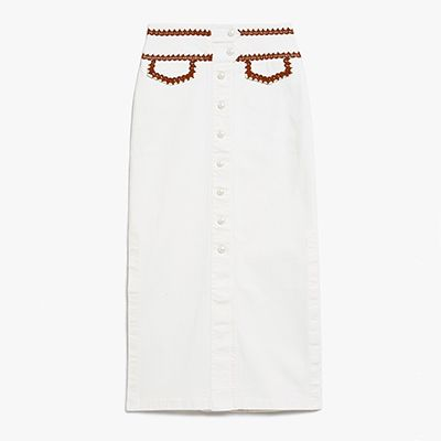 White denim pencil skirt with embroidered detailing.