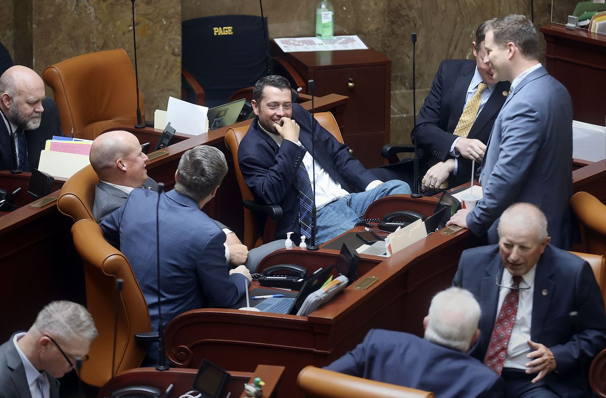 Lawmakers chat without masks during a special session of the Legislature at the Capitol in Salt Lake City on Wednesday, May 19, 2021.