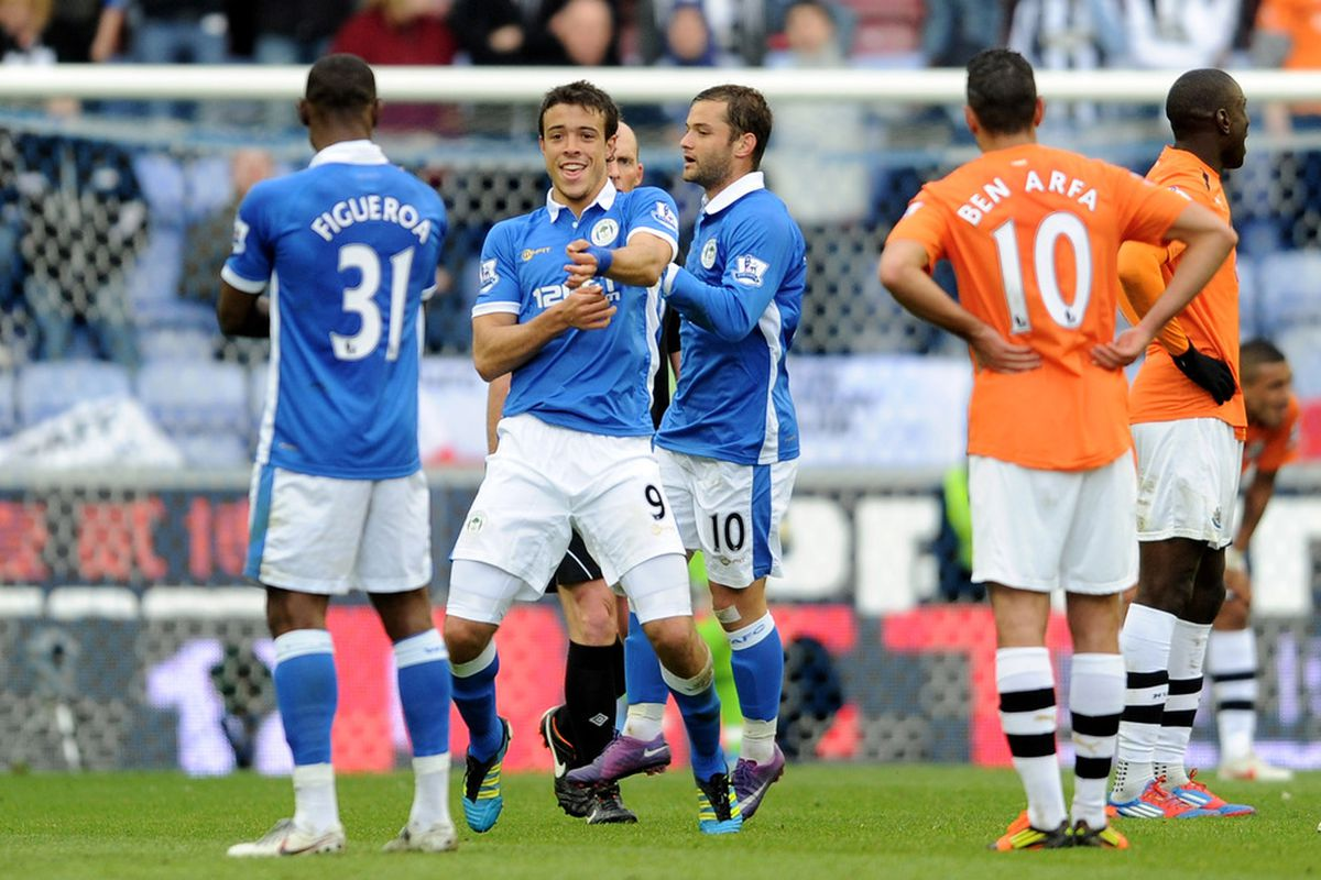 Franco Di Santo of Wigan Athletic celebrates scoring his team's fourth goal during the Barclays Premier League match between Wigan Athletic and Newcastle United at the DW Stadium.