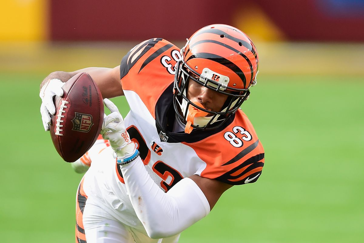 Tyler Boyd #83 of the Cincinnati Bengals carries the ball during the first half against the Washington Football Team at FedExField on November 22, 2020 in Landover, Maryland.