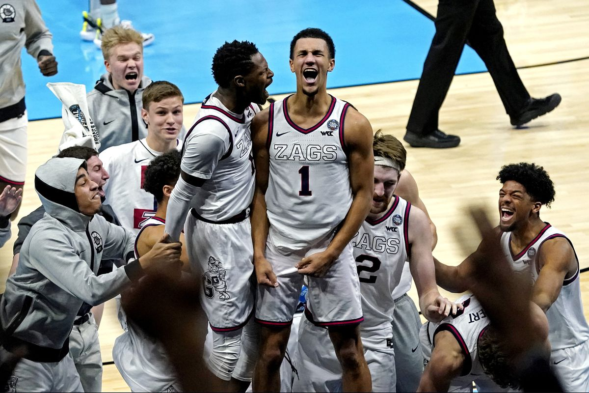 Gonzaga Bulldogs guard Jalen Suggs celebrate making the game winning shot against the UCLA Bruins in the national semifinals of the Final Four of the 2021 NCAA Tournament at Lucas Oil Stadium.