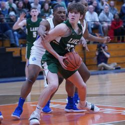 Lane's Louis Perona (23) spins towards the basket against Proviso East, Wednesday 02-27-19. Worsom Robinson/For Sun-Times