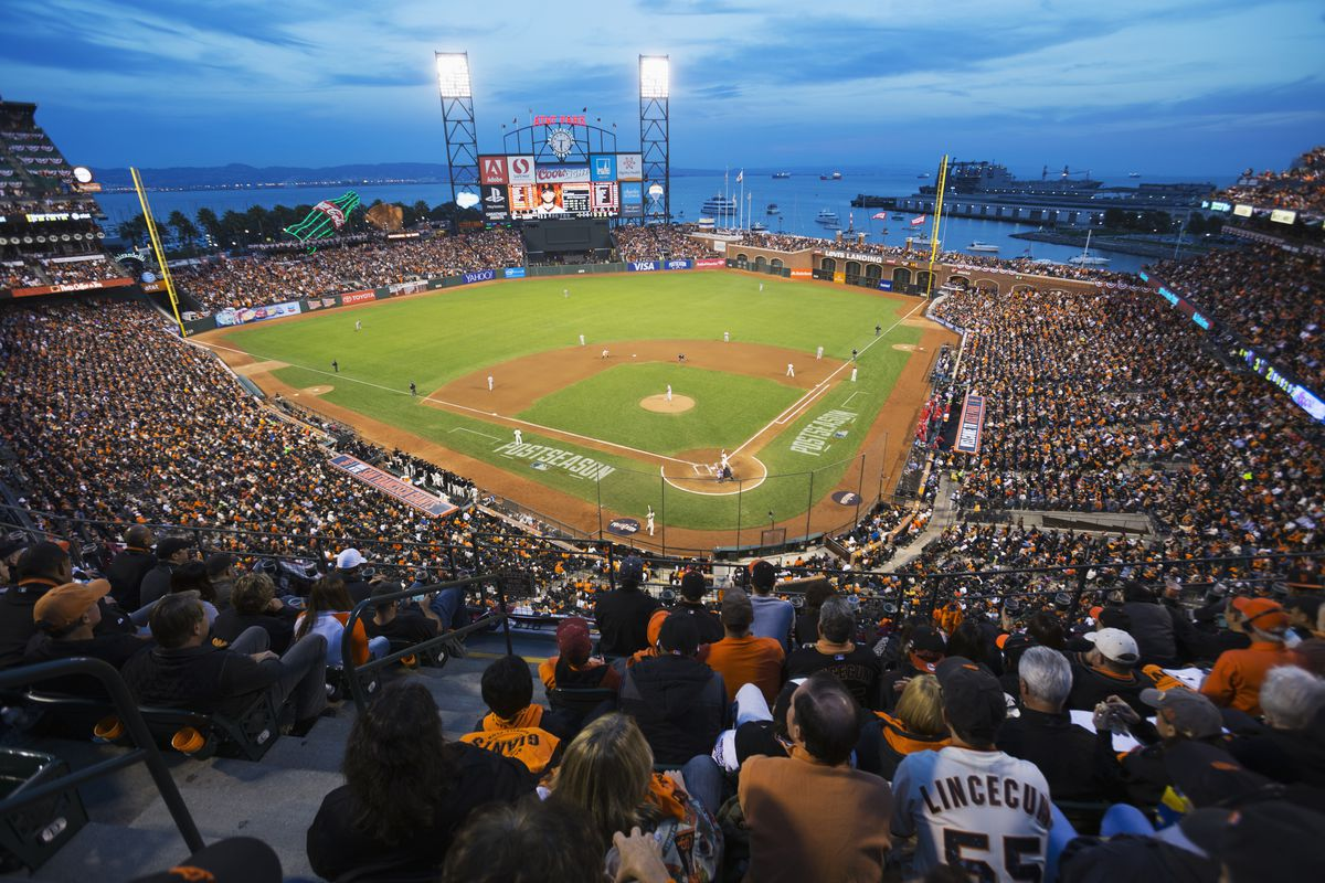 AT&T Park at night, filled with fans.