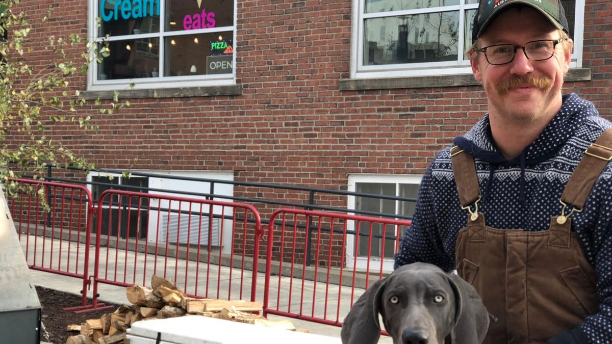 Jon Wipfli on a cold day outside of Able Seedhouse + Brewery with his blue gray Weimaraner.