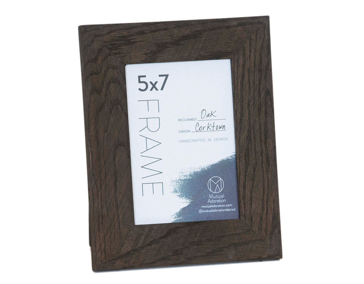 A wooden picture frame made out of reclaimed wood.