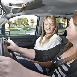 Kellie Wright of West Jordan talks with her daughter, Sara Weymouth, 15, about how to drive an automobile safely.