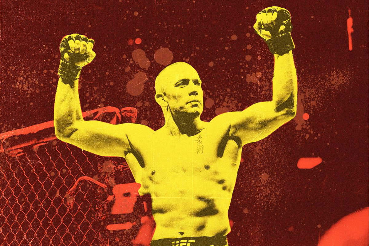 UFC fighter Georges St-Pierre in the octagon, shirtless with his fists raised