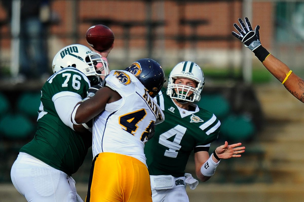 Ohio Bobcats quarterback Tyler Tettleton throws a pass against Kent State in a game in 2009. Photo Credit: Joel Hawksley