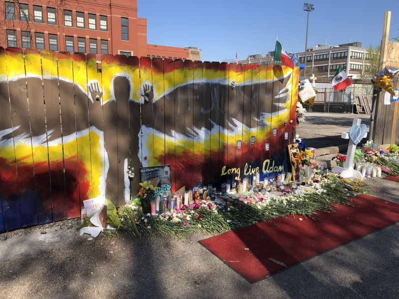 A makeshift shrine occupies the gap in the fence where 13-year-old Adam Toledo stopped and was shot by Chicago police officer.
