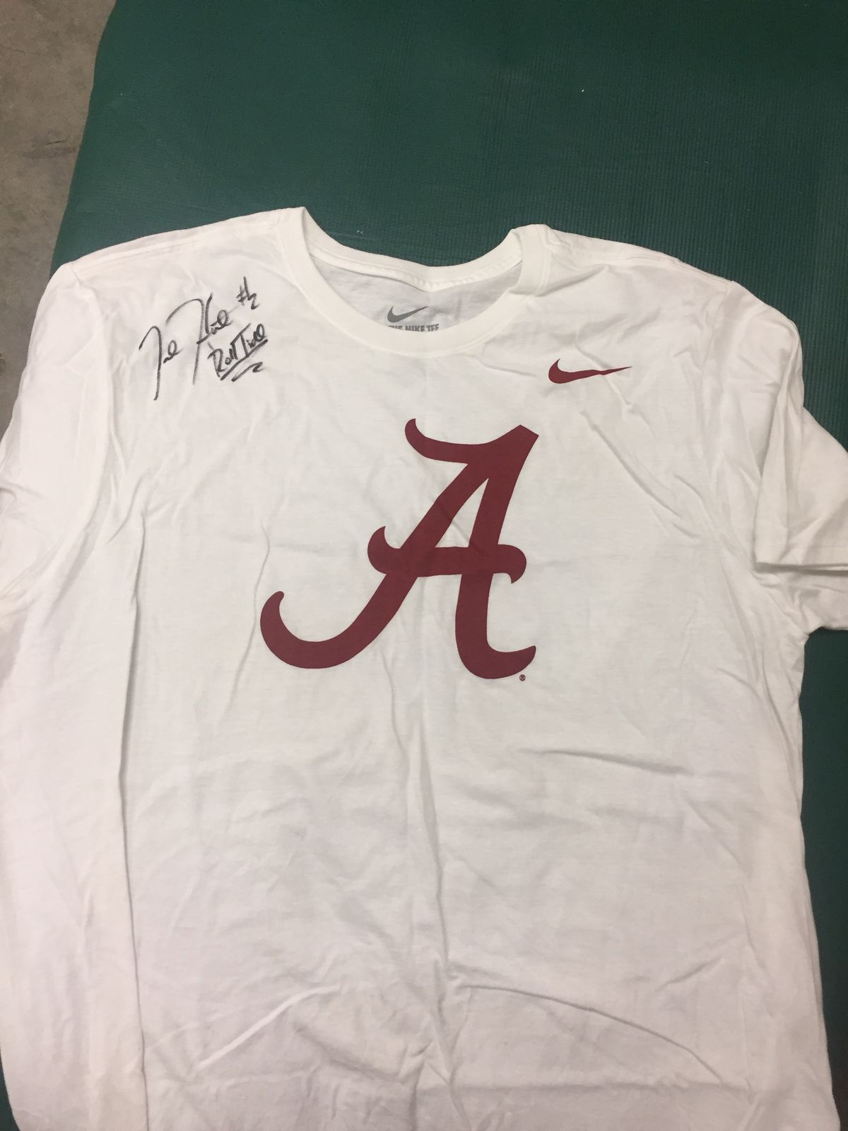 44da2e977 A white Alabama shirt autographed by Jalen Hurts on the right shoulder