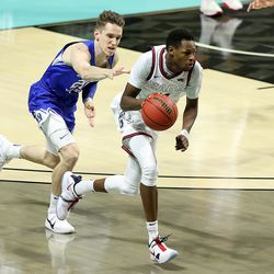 Brigham Young Cougars guard Spencer Johnson (20) reaches out to try to foul Gonzaga Bulldogs guard Joel Ayayi (11) as BYU and Gonzaga play in the finals of the West Coast Conference tournament at the Orleans Arena in Las Vegas on Tuesday, March 9, 2021. Gonzaga won 88-78.
