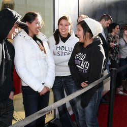 Storm Hogue, left, Ona Raymond, Jessica Hamlin and Cayla Yellowman line up to shop at City Creek Center in Salt Lake City, Thursday, March 22, 2012.