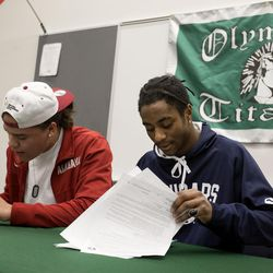 Olympus High School football players Cameron Latu signs with Alabama and Brach Davis signs with BYU at Olympus High in Holladay on Wednesday, Dec. 20, 2017.
