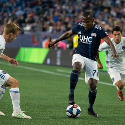 FOXBOROUGH, MA - MAY 11: New England Revolution forward Cristian Penilla #70 takes on a San Jose Earthquakes defender during the first half at Gillette Stadium on May 11, 2019 in Foxborough, Massachusetts. (Photo by J. Alexander Dolan - The Bent Musket)