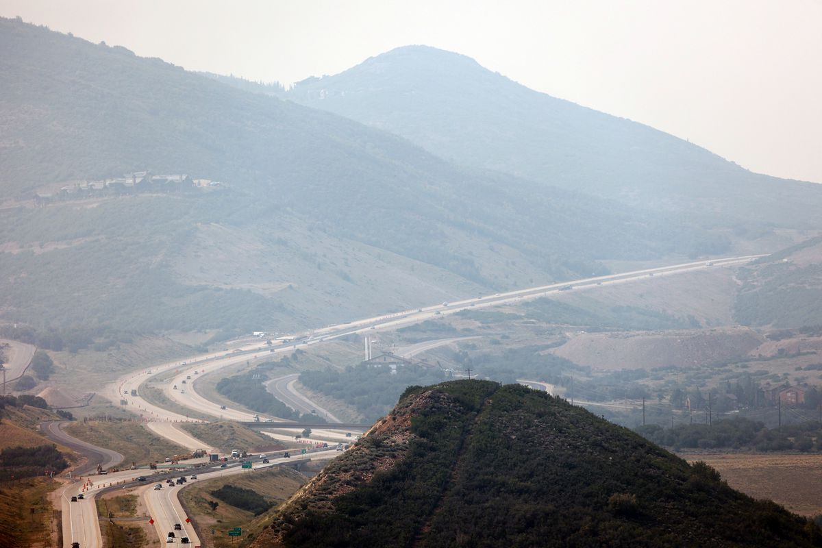 Cars travel on SR189 new Jordanelle Reservoir as crews continue fighting the Parley's Canyon Fire near Park City on Sunday, Aug. 15, 2021.