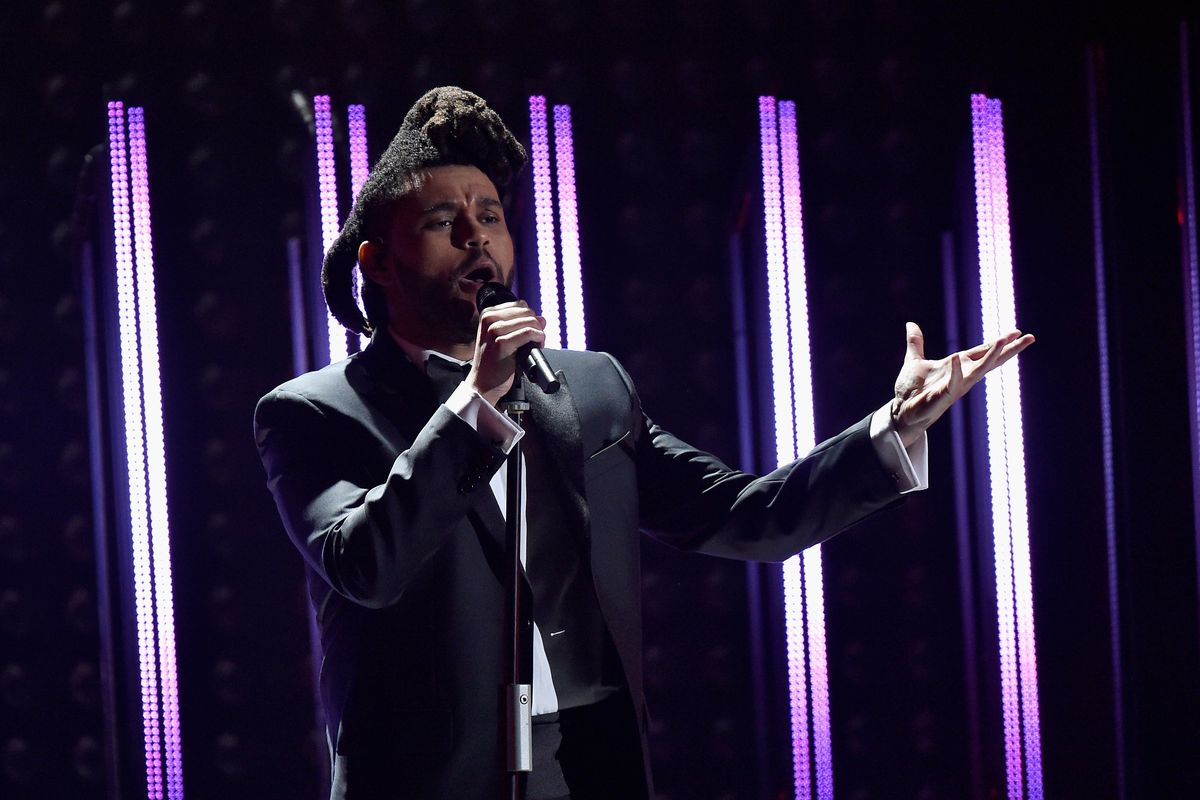 The Weeknd performs onstage during the 58th Grammy Awards in Los Angeles, California.