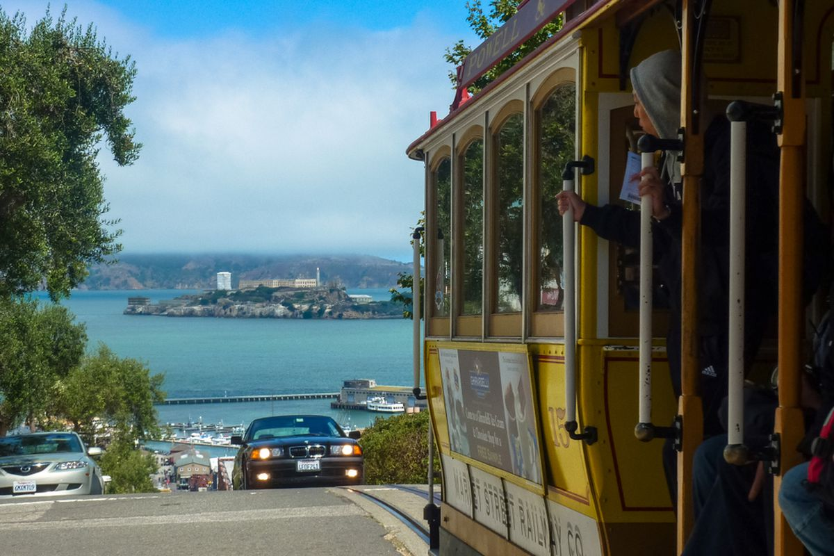 An SF Cable Car cresting a hill.