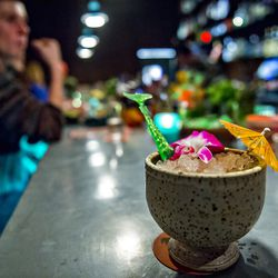 A Rough 'N Rowdy comes complete with an umbrella, a hibiscus flower, and a swordfish stirrer at The SOS.