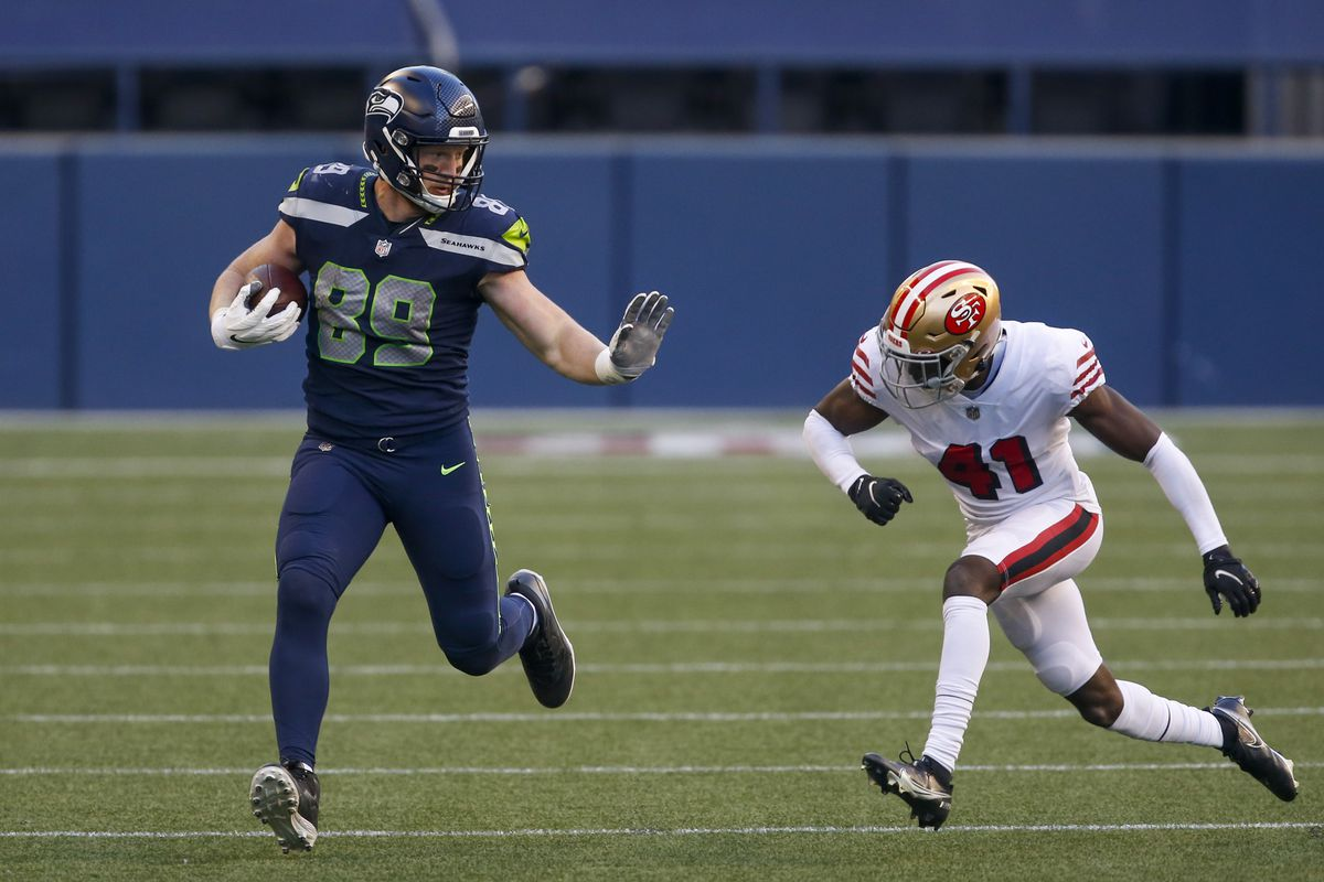 Seattle Seahawks tight end Will Dissly (89) runs for yards after the catch as San Francisco 49ers cornerback Emmanuel Moseley (41) closes in for a tackle during the fourth quarter at CenturyLink Field.