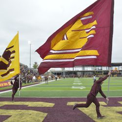 """The reverse side of the """"Flying C"""" flags can be seen during the celebration of the touchdown run."""