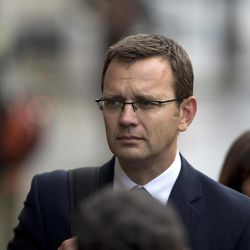 Andy Coulson, the ex-communications chief for Prime Minister David Cameron and former editor of the News of the World queues up as he arrives for his phone hacking case at the Old Bailey court in the City of London, Wednesday, Sept. 26, 2012.  Eight people are appearing in court to face charges connected to the phone hacking scandal that rocked Rupert Murdoch's News Corp. empire.  Rebekah Brooks, the former chief of News Corp.'s British newspapers, and Andy Coulson were among those appearing in court Wednesday.