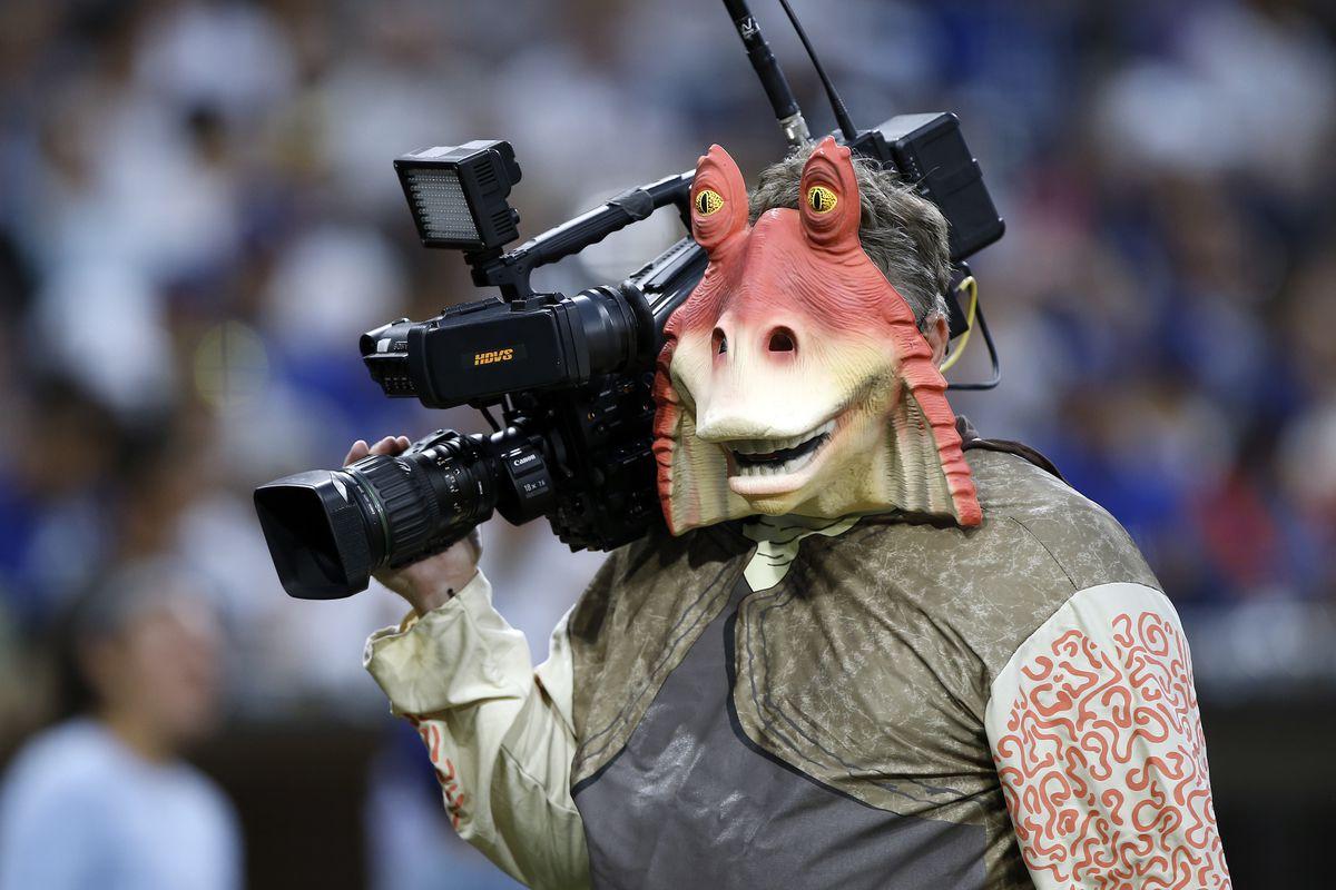 PetCo Park television cameraman Ron Sharek, dressed as Star Wars's Jar Jar Binks, walks on the field before a baseball game between the Los Angeles Dodgers and San Diego Padres in San Diego, Friday, Sept. 1, 2017. (AP Photo/Alex Gallardo)
