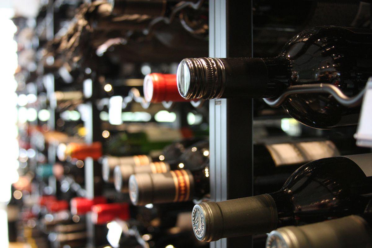 Bottles of wine on a shelf in a shop.