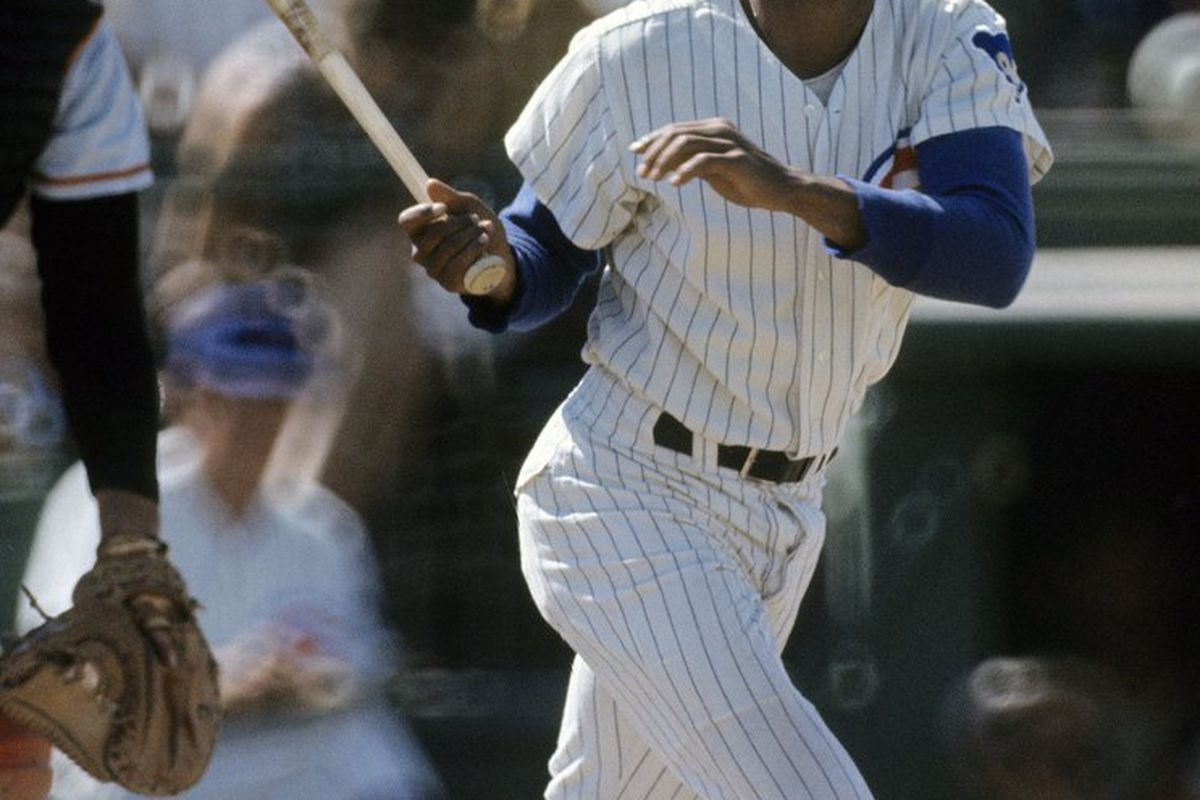 Billy Williams of the Chicago Cubs swings and watches the flight of his ball during a spring training Major League Baseball game. Williams played for the Cubs from 1959-74. (Photo by Focus on Sport/Getty Images)