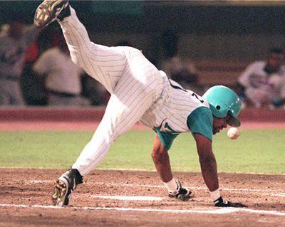 Marlin's center fielder Jesus Tavarez get hit by a