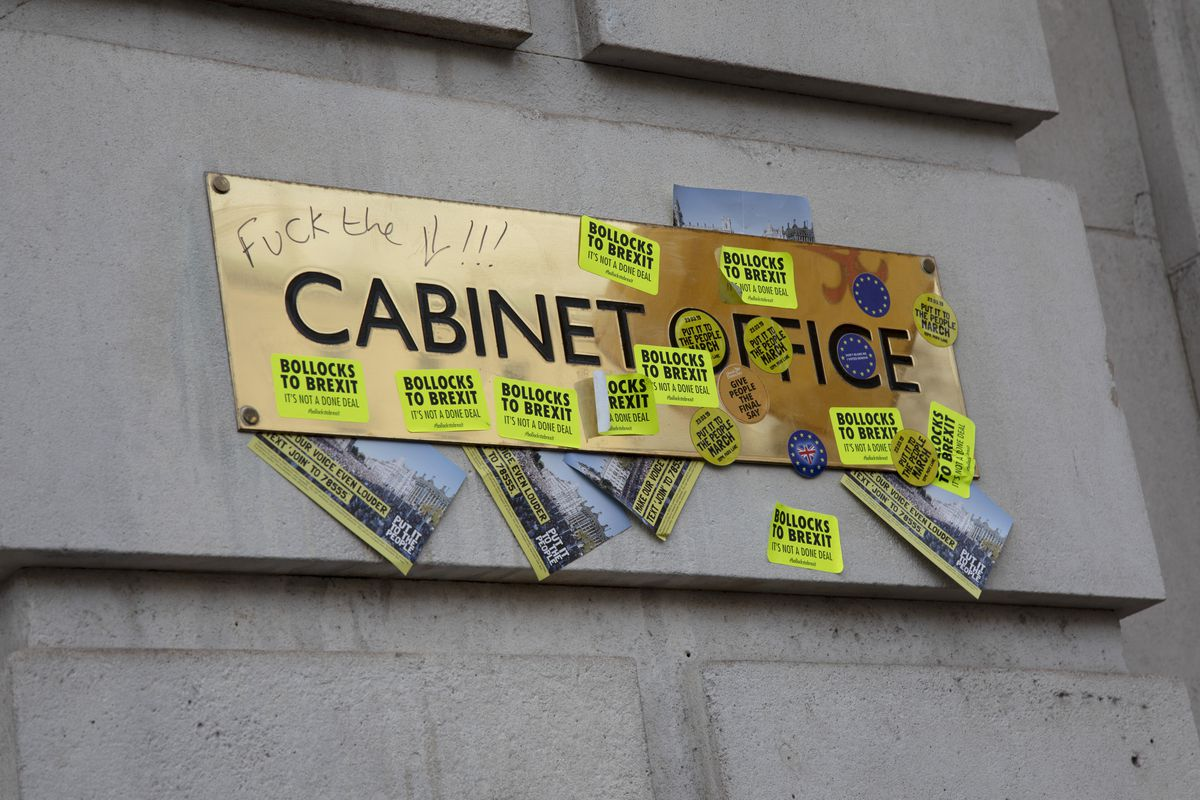 Demonstrators defaced the doors of the UK's Cabinet Office with anti-Brexit stickers during the People's Vote anti-Brexit march in London on March 23, 2019.