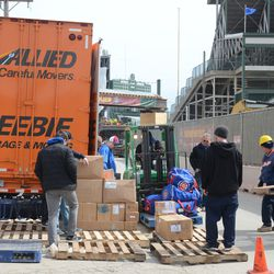 12:36 p.m. The Cubs gear truck being unloaded on Waveland -