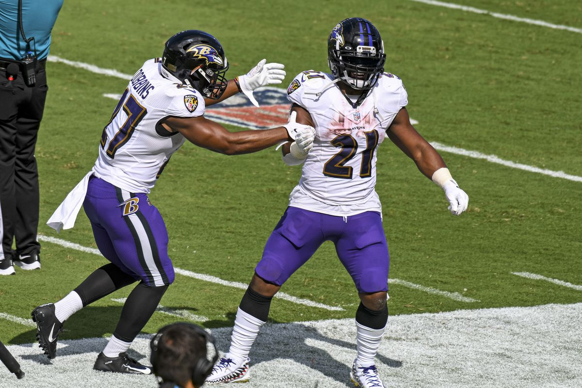 Baltimore Ravens running back Mark Ingram (21) celebrates with running back J.K. Dobbins (27) after his touchdown against the Cleveland Browns on September 13, 2020, at M&T Bank Stadium in Baltimore, MD.