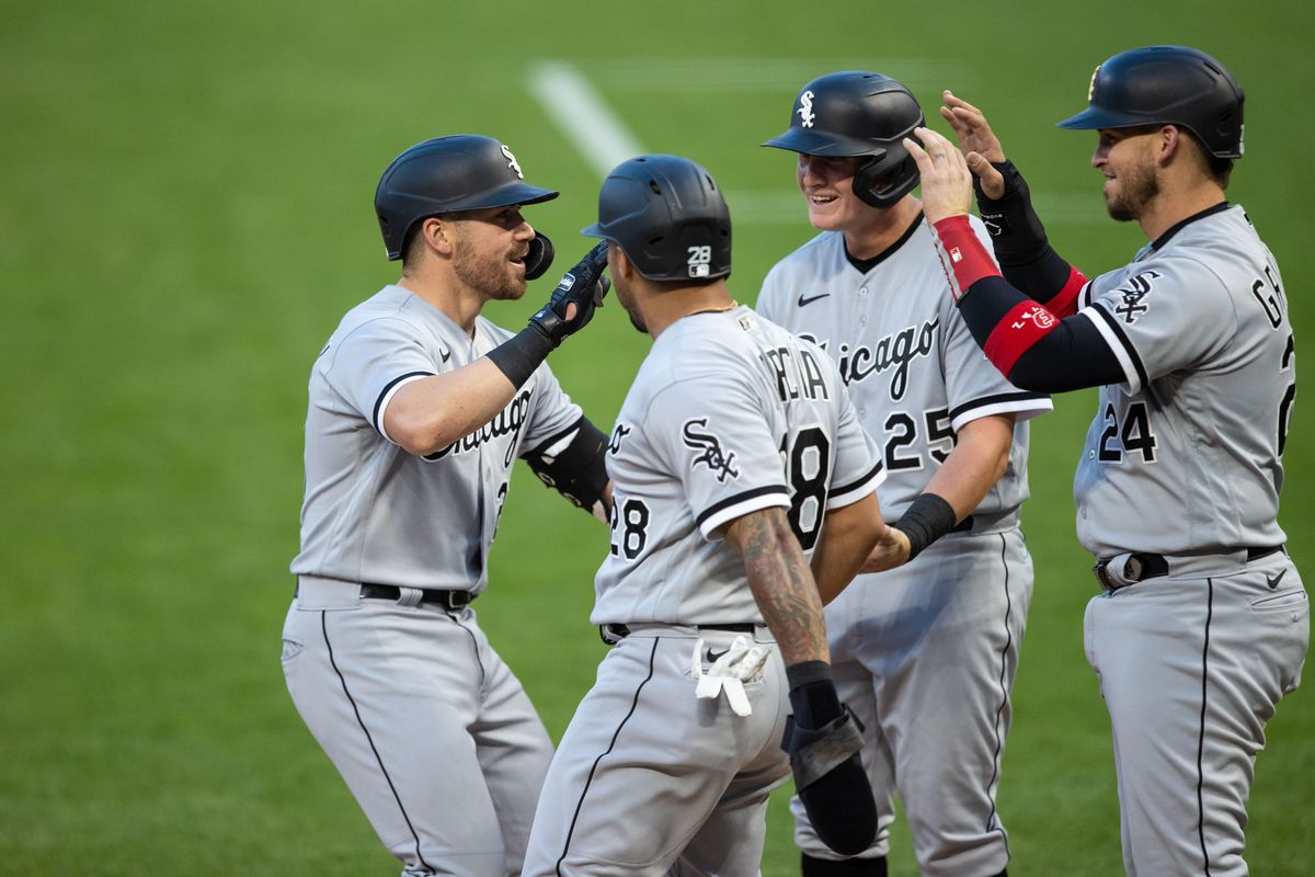 Chicago White Sox right fielder Danny Mendick celebrates with left fielder Leury Garcia first baseman Andrew Vaughn catcher Yasmani Grandal after hitting a grand slam during the fifth inning against the Minnesota Twins at Target Field.