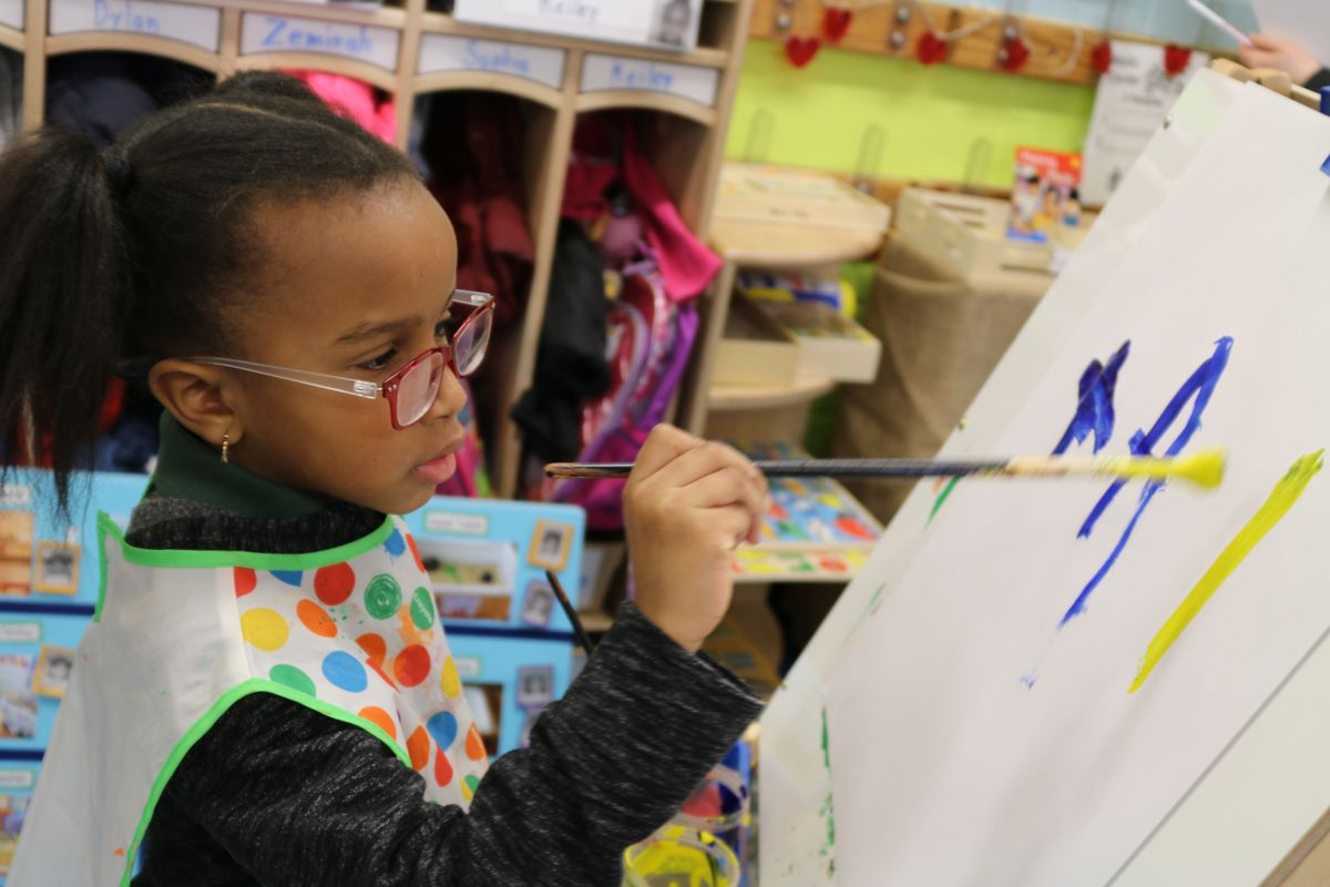 A student at P.S. 69 Journey Prep in the Bronx paints a picture. The school uses a Reggio Emilia approach and is in the city's Showcase Schools program.