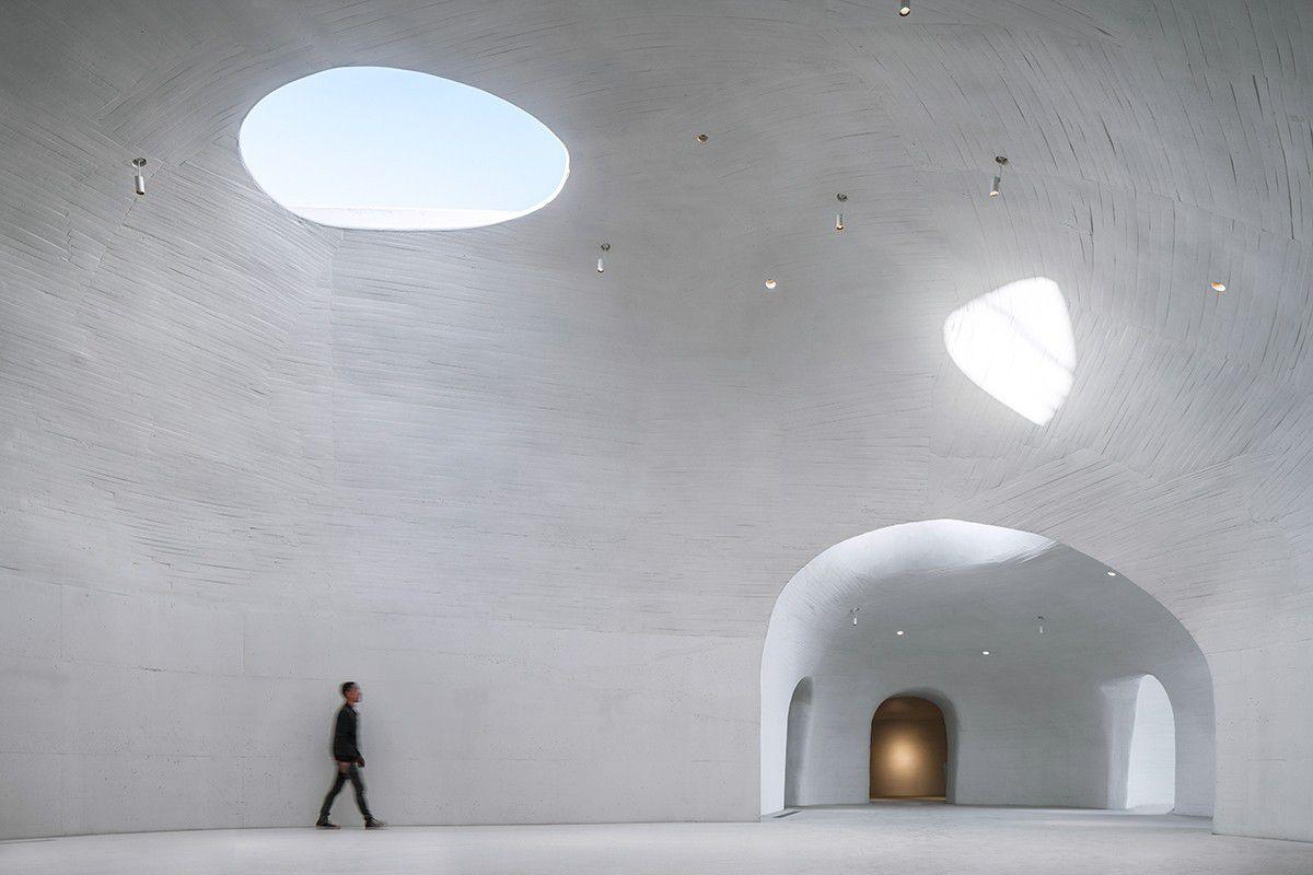Man inside white gallery