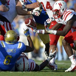 UCLA running back Jordon James, left, coughs up the ball as Nebraska safety P.J. Smith reaches for it during the first half of their NCAA football game on Saturday, Sept. 8, 2012, in Pasadena, Calif. Nebraska recovered the ball. (AP Photo/Mark J. Terrill)