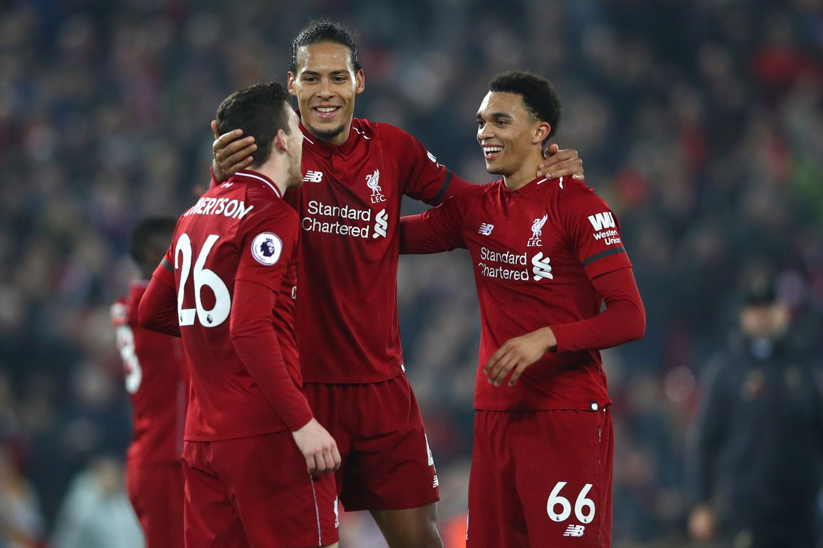Virgil van Dijk celebrates victory with Trent Alexander-Arnold and Andy Robertson - Liverpool FC - Premier League