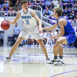 Sky View's guard Mason Falslev (12) drives the ball against Dixie during the 4A boys championship basketball game at the Dee Events Center in Ogden on Saturday, Feb. 29, 2020.