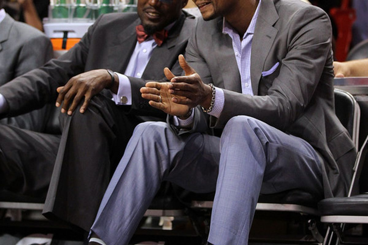 MIAMI FL - JANUARY 22: Chris Bosh #1 of the Miami Heat talks with assistant coach Keith Askins during a game against the Toronto Raptors at American Airlines Arena on January 22 2011 in Miami Florida. (Photo by Mike Ehrmann/Getty Images)