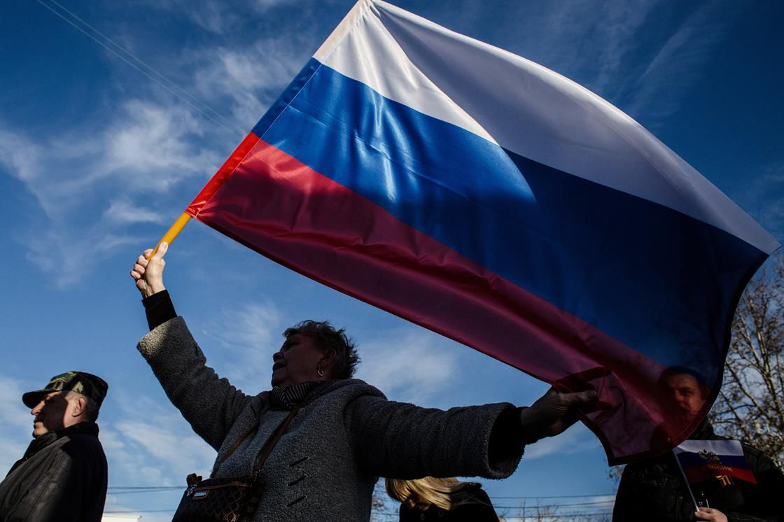 Woman holding Russian flag