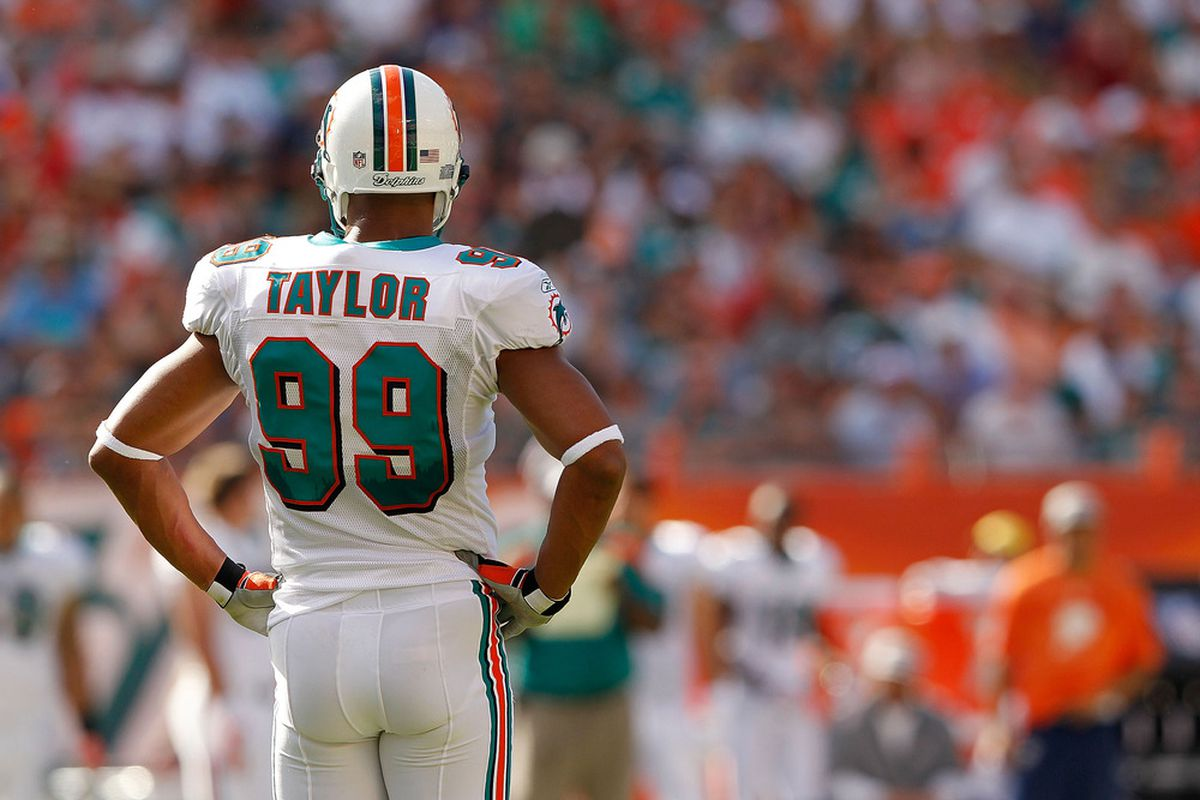 MIAMI GARDENS, FL - JANUARY 01:   Jason Taylor #99 of the Miami Dolphins looks on during a game against the New York Jets at Sun Life Stadium on January 1, 2012 in Miami Gardens, Florida.  (Photo by Mike Ehrmann/Getty Images)